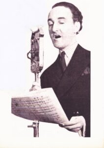Maurice Elwin in Front of the Microphone